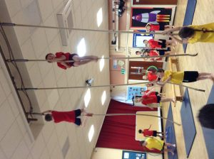 Year 3 doing gymnastics using apparatus